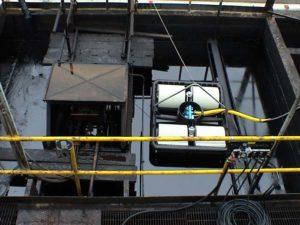 skimmer a rulli aron in sostituzione di un discoil in vasca di una centrale elettrica